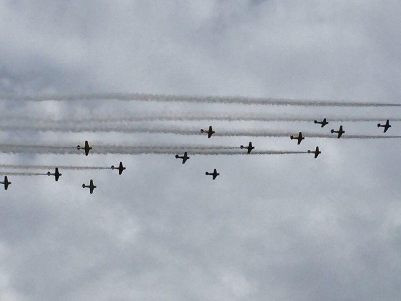 More airshow fly overs by masses of WWII planes.