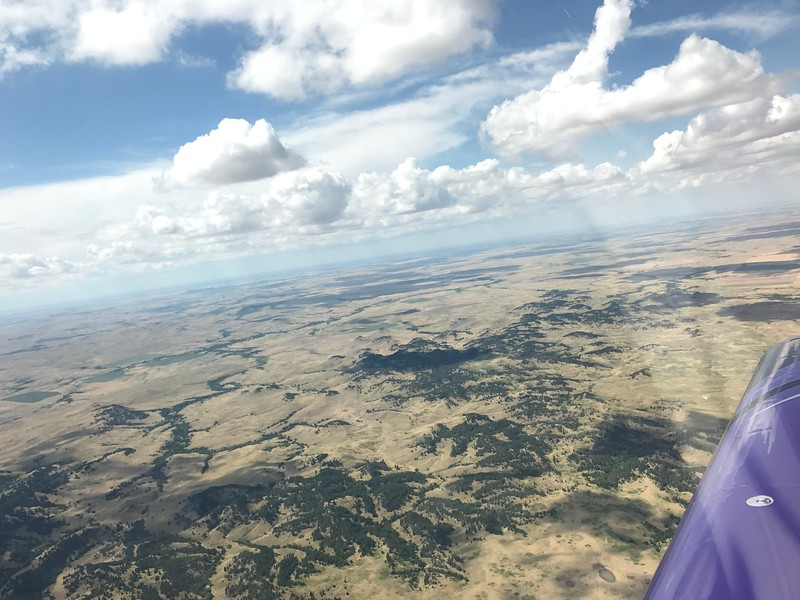 Our longest leg was from Iowa to Hot Springs, SD. We flew above the clouds for a while, then they started getting too high, then we were down below them and ended up dodging some thunderstorms near Hot Springs.