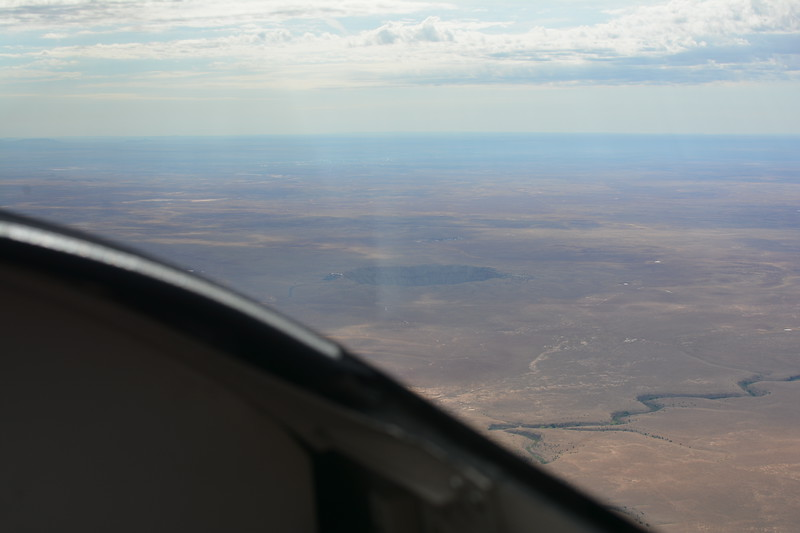 A crater in the distance.