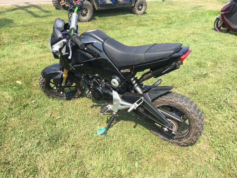 Nice set of knobbies on this Honda Grom. Good for the wet conditions, I'm sure.