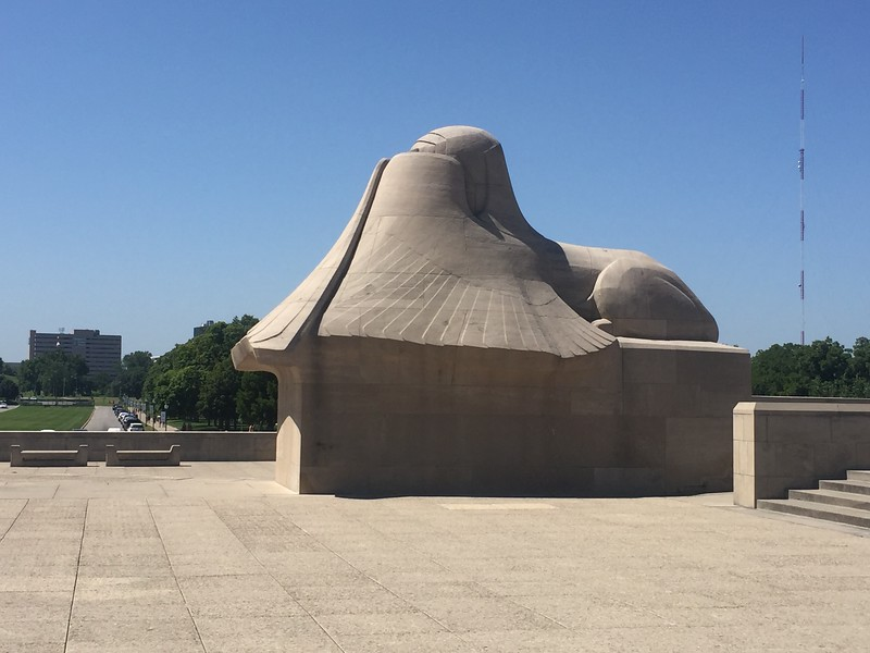 There are two big sphinx sculptures with their faces covered for the past and fear of the future.