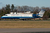 After a bit of a wait on the hold pad, this United Express CRJ rolls down runway 28 for departure.
