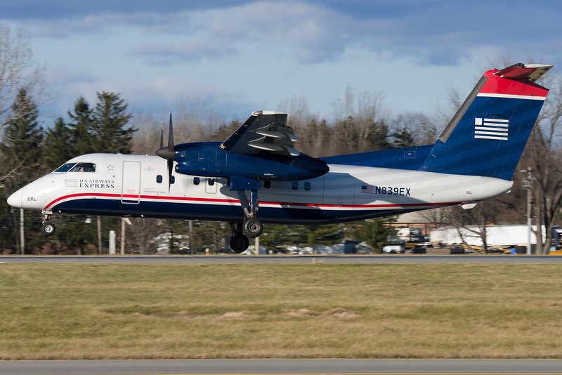 This Dash 8 is fighting a bit of a crosswind as it lands on runway 28.