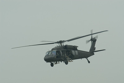 Blackhawk helo with Spec Ops banking away