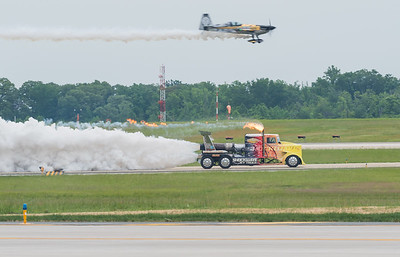 Shockwave Jet Truck racing with the airplane