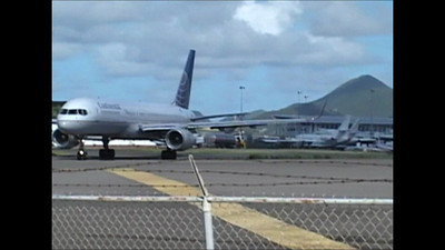 Boeing 757 Taking Off and people getting sand blasted by the jet @ Princess Juliana International Airport - Maho Beach - St. Maarten