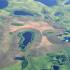 North Dakota farming around the small ponds and rock piles
