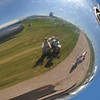 Reflection of the group in the chromed prop hub.