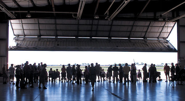 Chronicle photo HOLLY LUNDH Spectators wait inside a hanger at Taylor Airport for the arrivial of the B-17 bomber Tuesday afternoon in DeKalb.