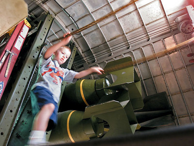 Chronicle photo HOLLY LUNDH A child (didn't get name) walks across a walkway inside the B-17