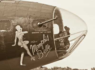 Nose art on the Memphis Belle.  The 50 caliber Browning machine gun is seen as well as the Norden bomb sight in the cupola for the bombardier