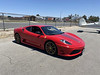 Not a rocket, but it is red and fast. Ferrari 430 Scuderia.