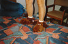 JIM TRIES THEM ON<br /> And the slippers don't look none too happy about it, either.