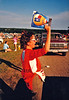 PAT THE PEDDLER<br /> Here's Susan's sister Pat again, this time selling programs at the one and only Falcon's Lair balloon event we ever participated in. It wasn't the greatest field in the world by any stretch of the imagination.