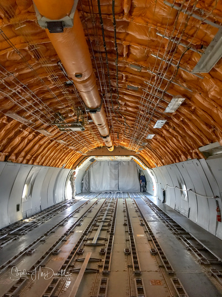 The interior cargo hold of a KC-10 refueling jet.  Max fuel load around 390,000lbs of fuel which is about 60,000 gals.
