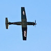 Hawker Beechcraft T-6 Texan II going knife edge.