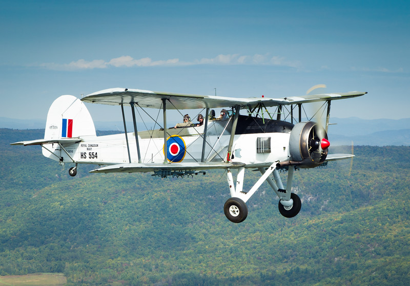 Vintage Wings of Canada's Fairey Swordfish over the Gatineau Hills.
