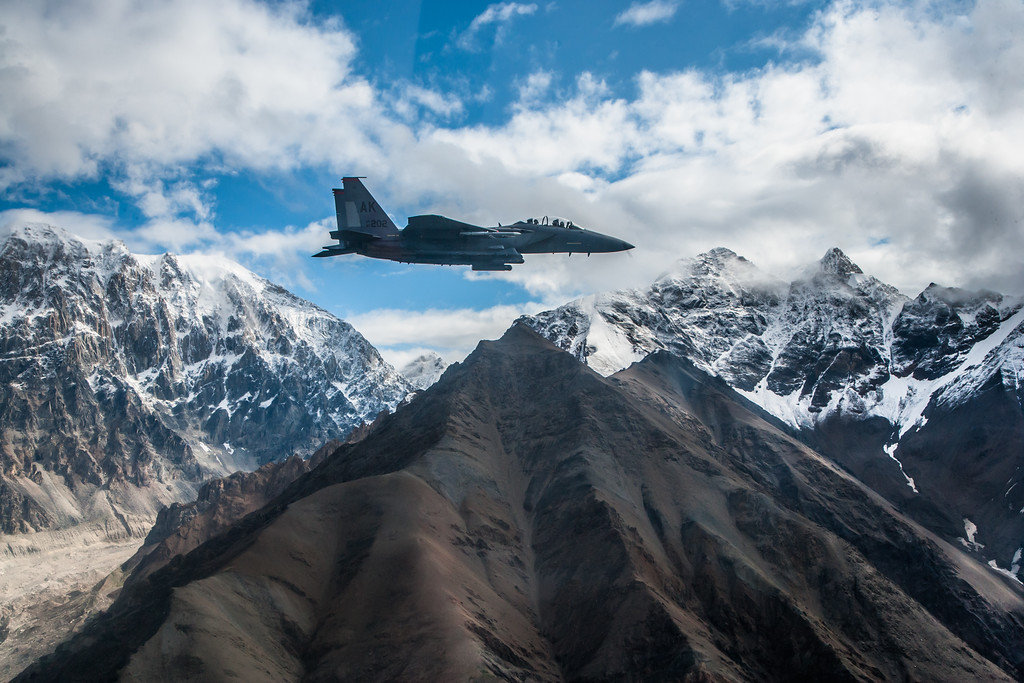 Colonel Randy 'R2' Roberts then-commander of the 3rd Operations Group wheels his 90th Fighter Squadron F-15E Strike Eagle through the Chugach Mountains in Alaska.