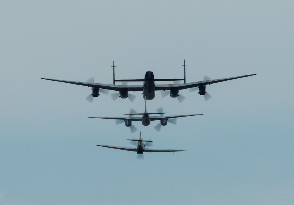 The Canadian Warplane Heritage Museum's Avro Lancaster lines up in silhouette with Jerry Yagen's deHavilland Mosquito, and Vintage Wings of Canada's Hawker Hurricane Mk.IV.