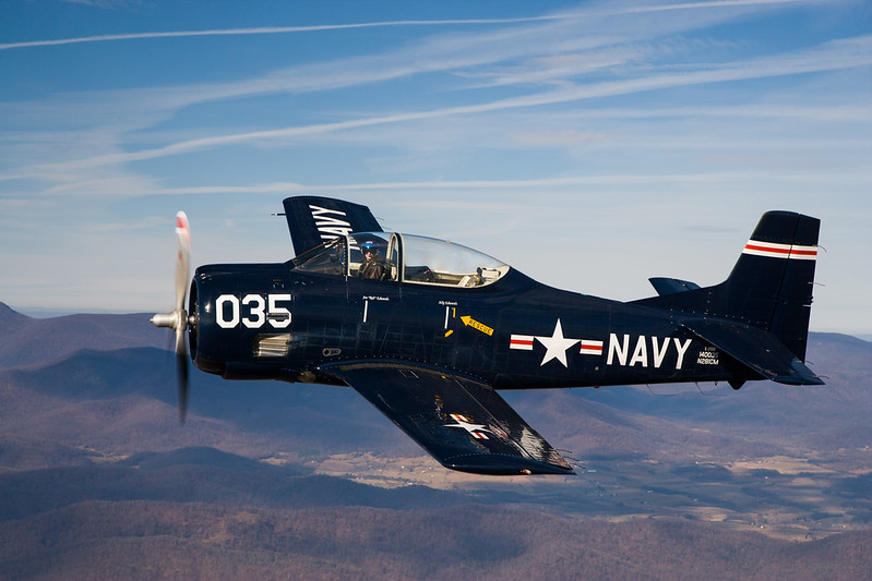 Former shuttle astronaut and F-14 test pilot, Joe Edwards wings his T-28 over the Blue Ridge Mountains, near Winchester, Virginia.