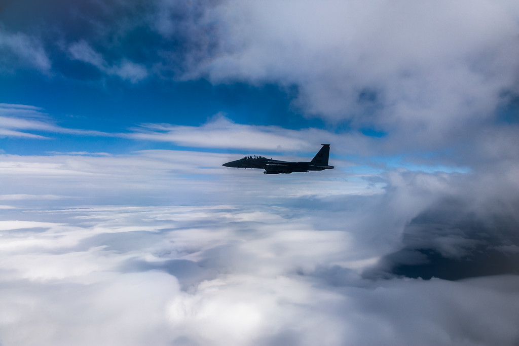 Colonel Randy 'R2' Roberts then-commander of the 3rd Operations Group flies his 90th Fighter Squadron F-15E Strike Eagle above the clouds over the Chugach Mountains in Alaska.