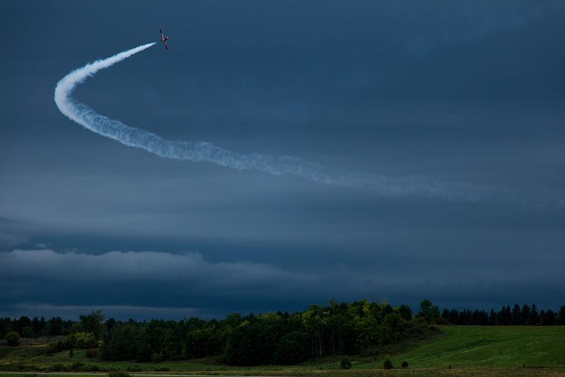 A lone Snowbird arcing through the thunderous sky at Gatineau, Quebec.