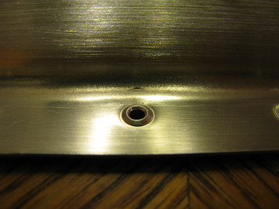 Rudder spar flange nicked from dimple die.