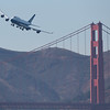 United Airlines 747 flies over Golden Gate Bridge