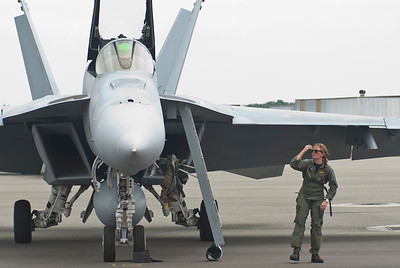 Fighter pilot from VFA-31, TOMCATTERS, finishing up her pre-flight.  VFA-31 is based out of Naval Air Station Oceana, VA