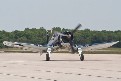 Vought F-4U Corsair.  Note the bent wings due to the 13 foot prop