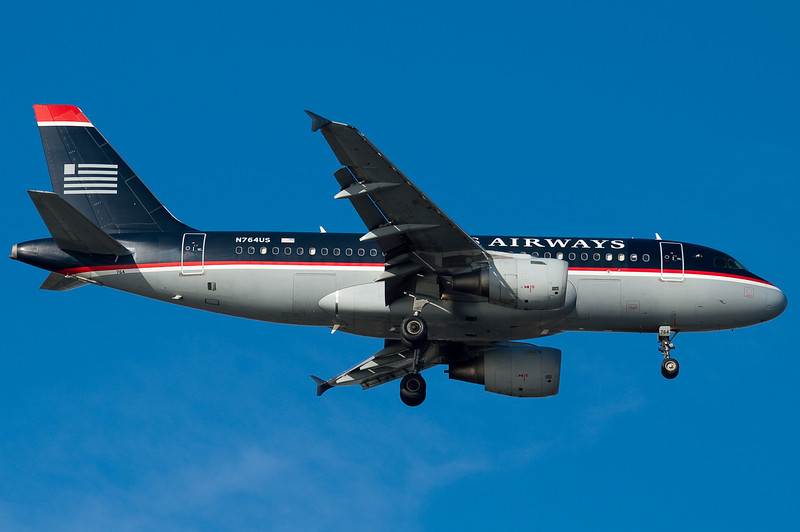 A US Airways A319 on final for runway 04R at BOS.