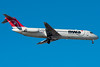 A Northwest DC-9-30, a rarer sight these days, is on final for runway 4R.