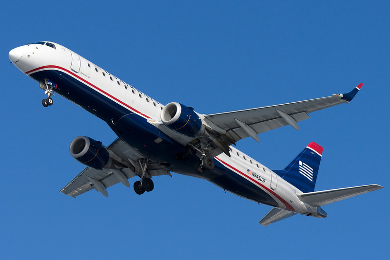 A US Airways E-190 on final for runway 27.