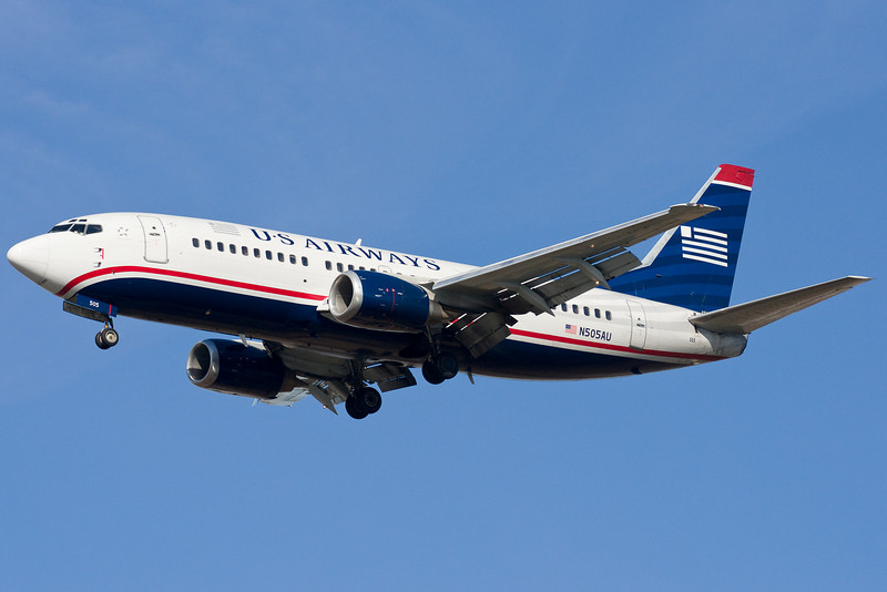 A freshly painted US Airways 737 on final for 22L.