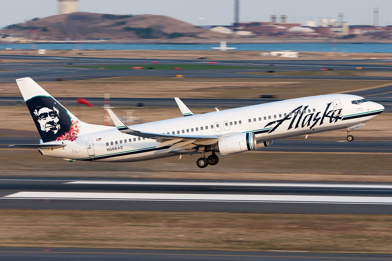 This Alaskan 737 sports a lei as it departs runway 22R.