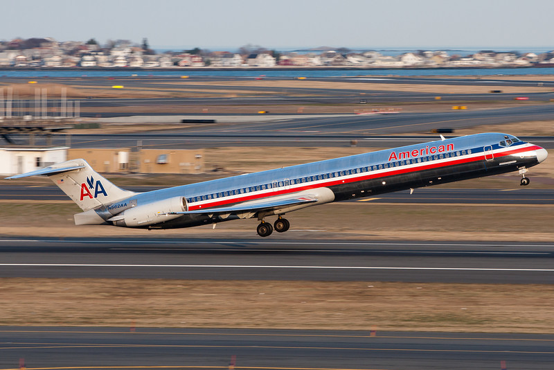 An American MD-82 lifts up from Logan's runway 22R.