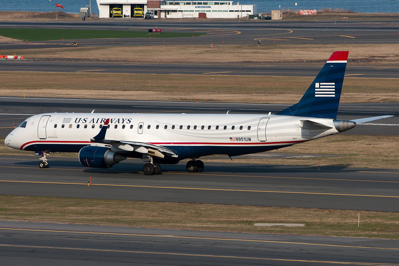 A US Airways E-190 taxis for departure.