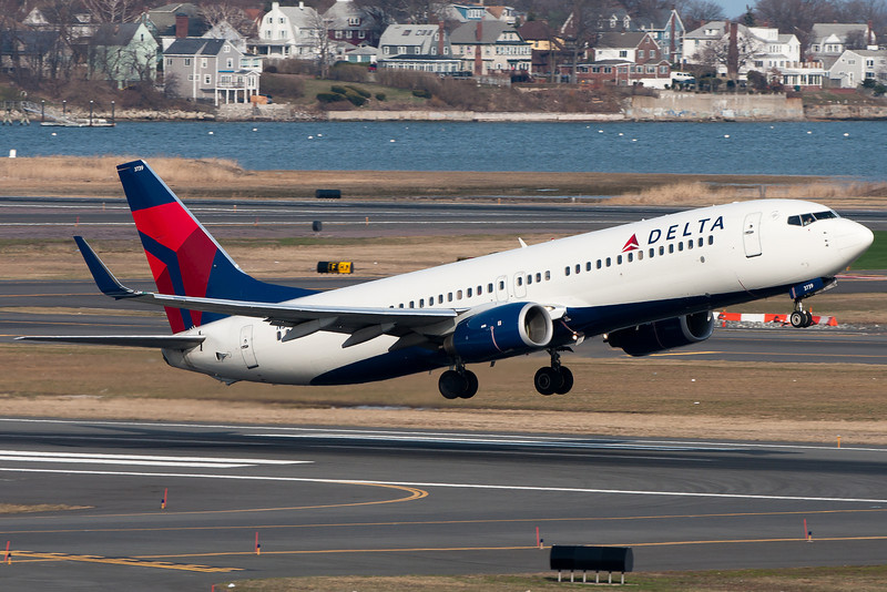 A Delta 737-800 pulls up from runway 22R.