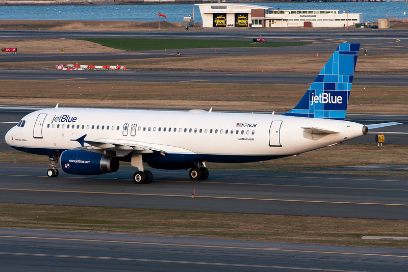 A JetBlue A320 taxis to the gates.