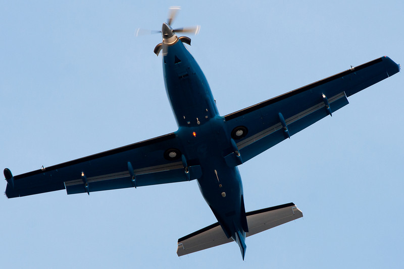 A Pilatus PC-12 flies overhead.