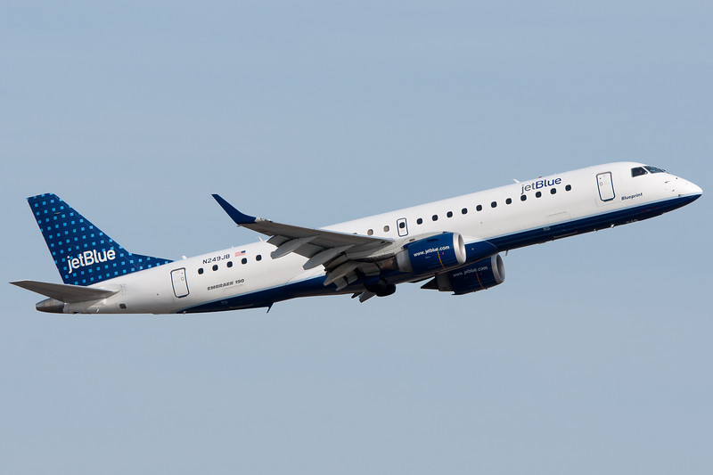 This JetBlue Embraer E-190 is tucking away its landing gear away and climbing out from Logan.