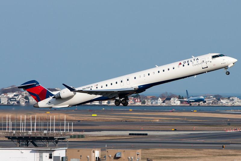 A Delta CRJ-900 departs Logan airport.