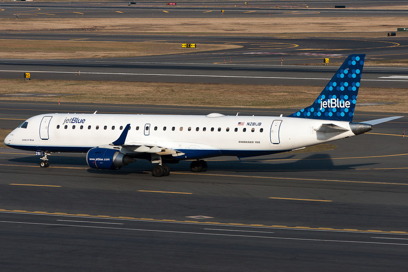 After landing on runway 27, this Jet Blue E-190 heads for its terminal C gate.
