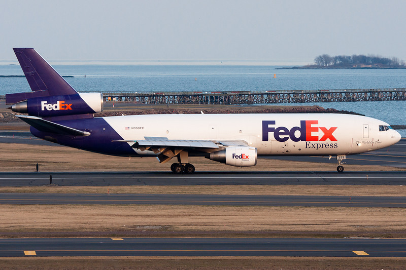 FedEx arrives right on schedule and rolls out runway 22L to head to the south cargo ramp.