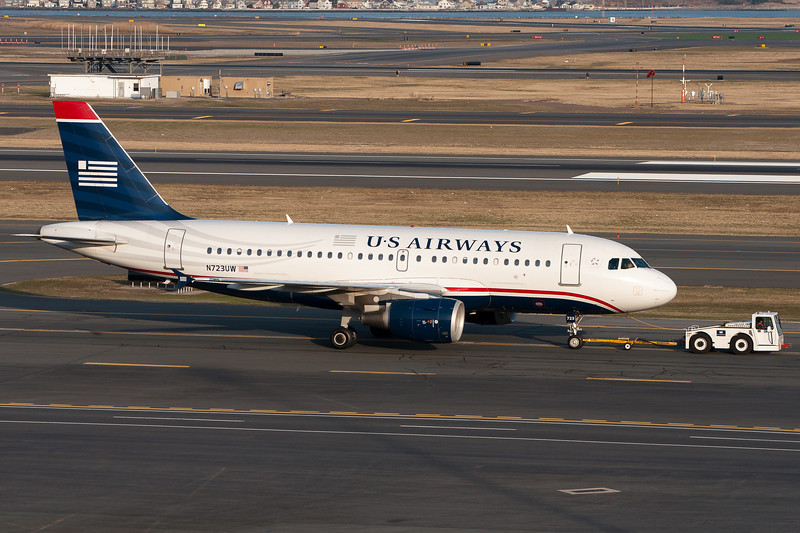 This US Airways A320 is getting a tug to the gate.