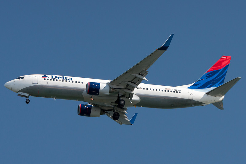 A Delta 737 with Winglets approaches Boston on final.