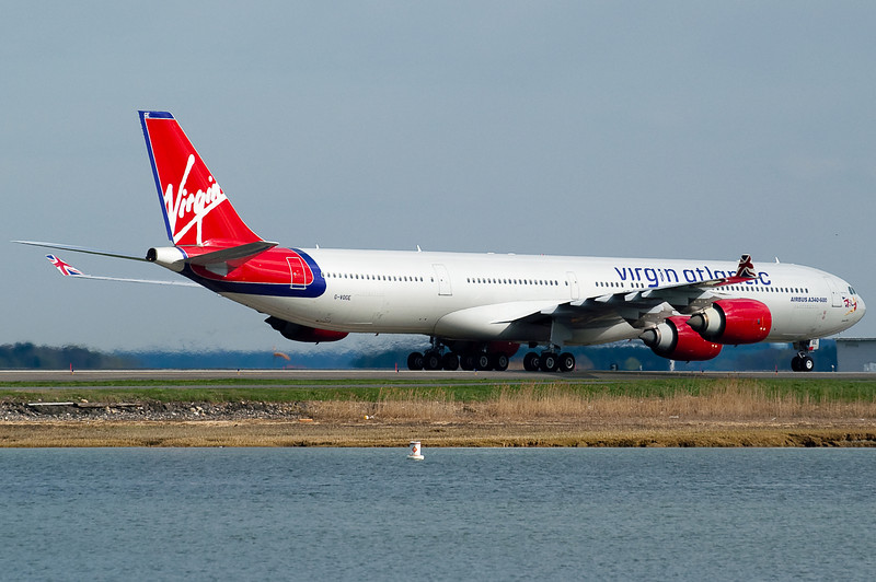 The Virgin Atlantic A340 has arrived and is taxiing towards the gate.