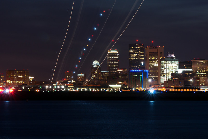 A Continental 737-500 arrives at Boston, creating a neat light show.
