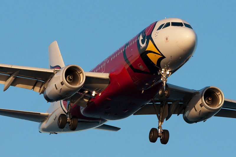 The US Airways Arizona Cardinals jet on final for runway 27.