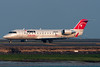Fewer and fewer red tails exist as this Northwest Airlink jet readies for departure.